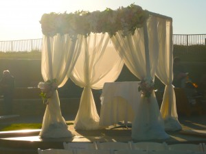 Chuppah with the sunset behind. An Elegant Touch of Strings performed as a string trio for this wedding.